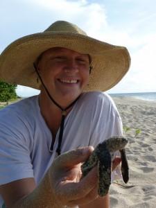 Jenifer Valiulis with a leatherback sea turtle hatchling